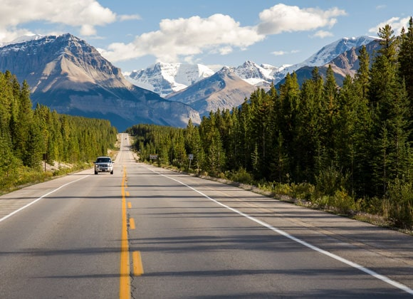 Car driving on the Icefields Parkway road in Canada