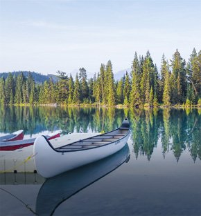 Canoes on lake in Alberta, Canada