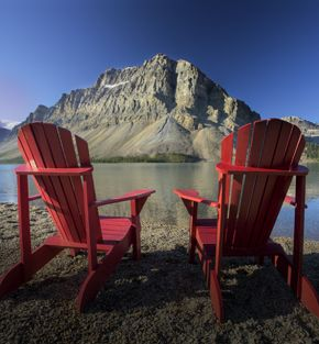 Two chairs looking across Bow Lake, Alberta