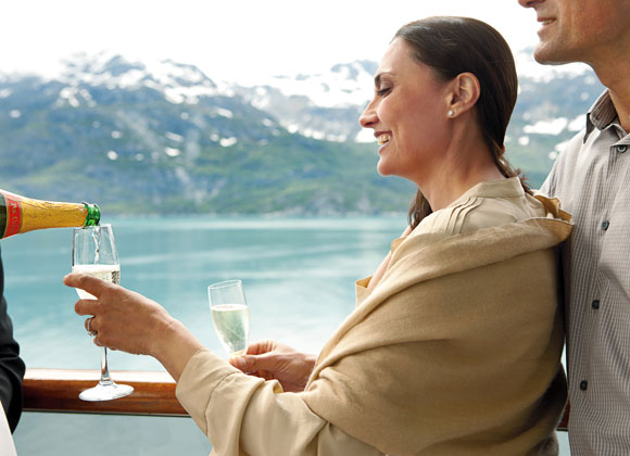 Woman with glass of champagne on cruise to Alaska