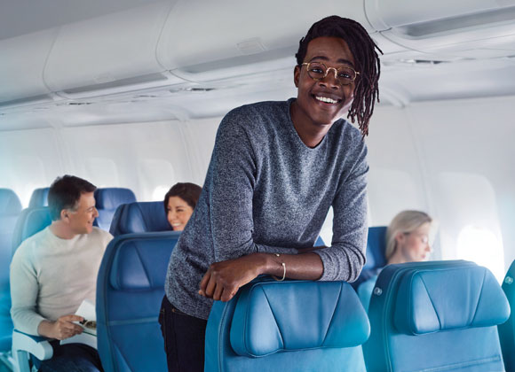 Man smiling on flight to Canada