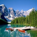 moraine lake with canoes