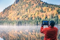 Man taking a picture of the Canadian scenery